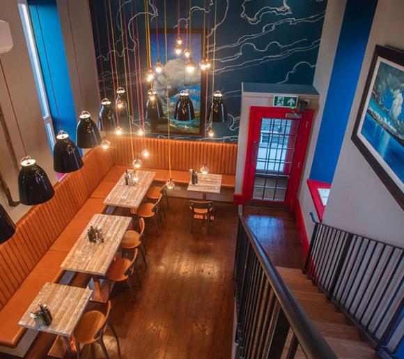 Dining area from the balcony in Peatzeria restaurant on Islay