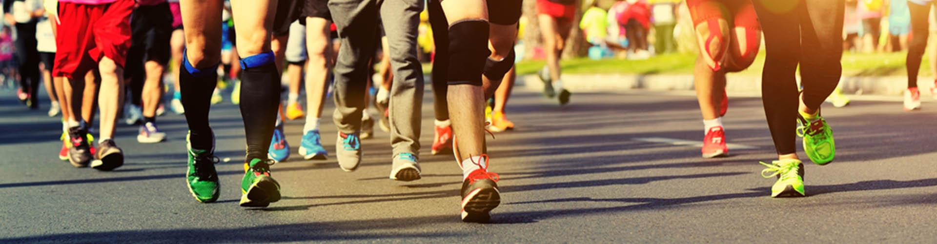 People's legs running a marathon