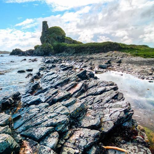 Lagavulin Bay and Dunyvaig Castle on the coastline of Islay