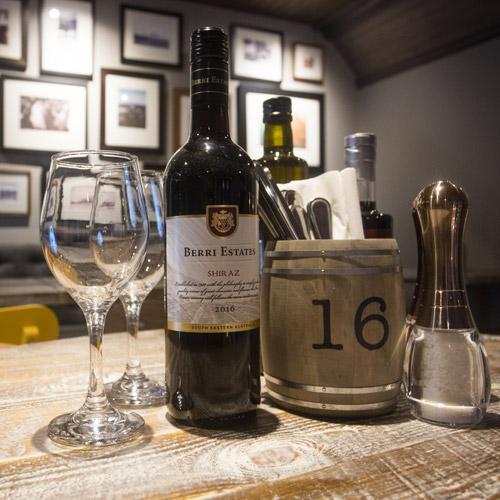 Wine bottle and glasses on restaurant table