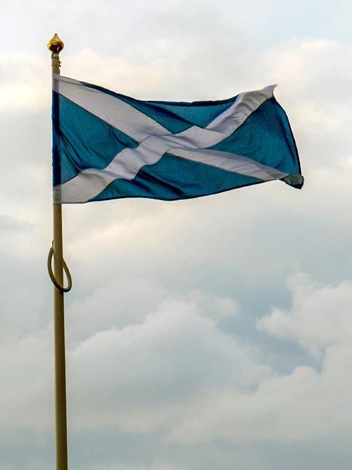 Scottish flag flying on a pole